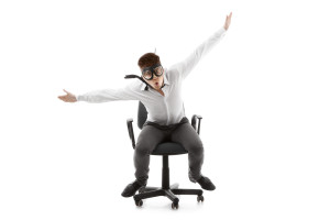 bigstock-Funny-Young-Man-On-Chair-34253222