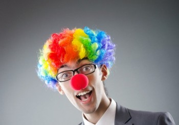 bigstock-Clown-businessman-in-funny-bus-23779583-678x1024