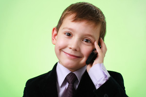bigstock_Smiling_Little_Boy_With_Cell_P_6509497